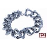 Bracelet têtes de mort entrelacées acier SBR016